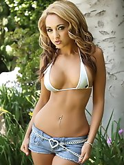 Tanned vixen Ashley is in the backyard in a tiny bikini top and short jean cutoffs