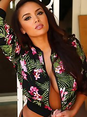 Busty perfect sex kitten Justene Jaro teases with a tiny unzipped jacket barely covering her big tits