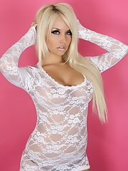 Busty blonde vixen Shannon teases with her huge breasts in a sexy little white lace top